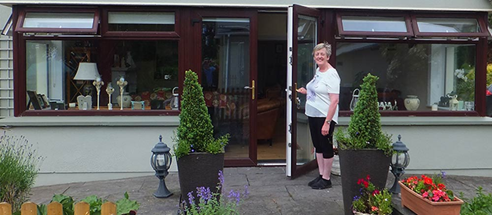 Liz holding the door open towelcoming you to Castleview B&B