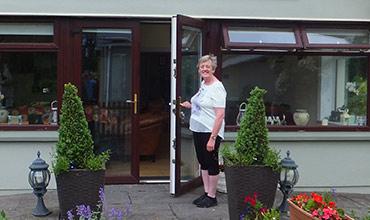Liz opens the door at Castleview B&B